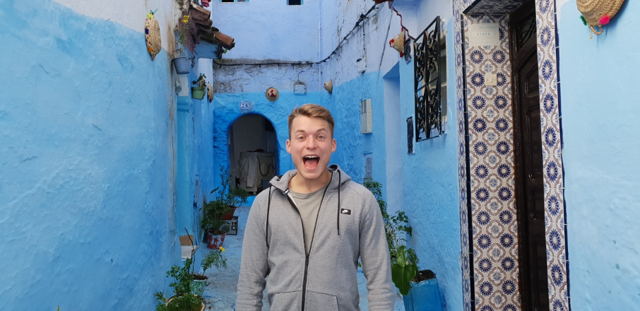 Kevin screaming in a blue alleyway with moroccan tile
