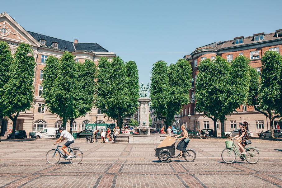 People biking in plaza in Copenhagen