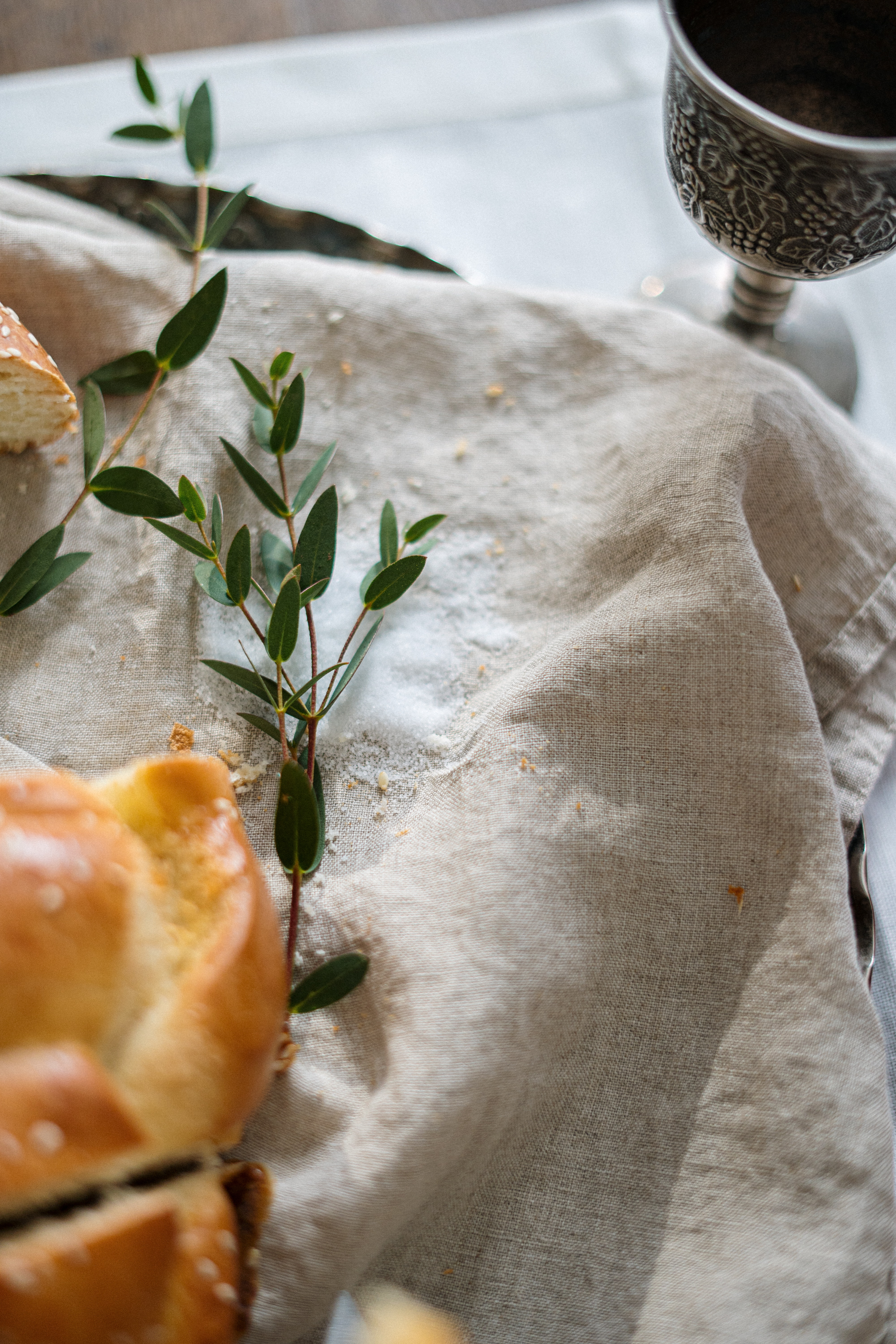 Pastries on a muslin cloth with green herbs